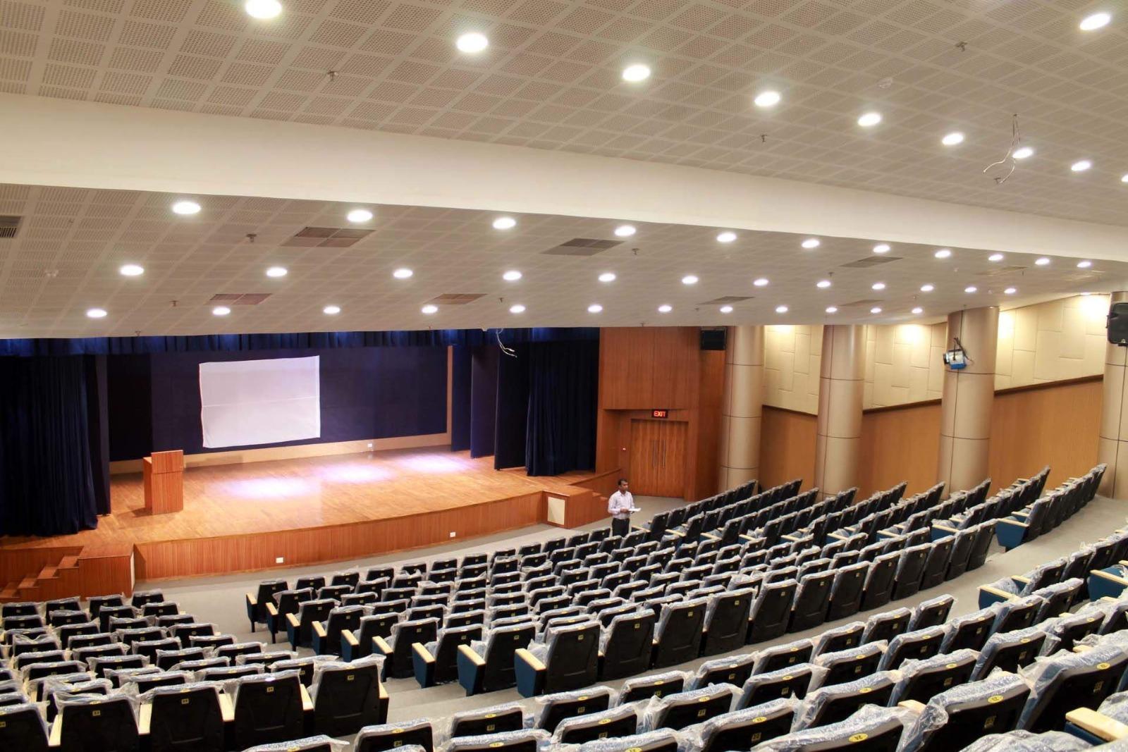 I need someone to decorate my auditorium