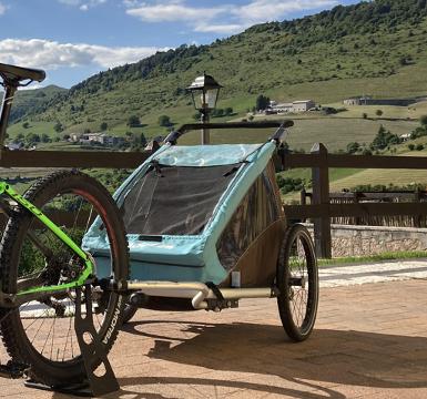 Noleggio rimorchio bici trasporta bambini - Erbezzo